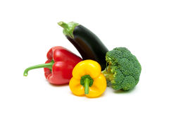 Sweet peppers, eggplant and broccoli isolated on white batskgrou Royalty Free Stock Image