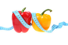 Sweet peppers and measuring tape Stock Photography
