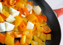 Sweet Peppers & Onion In Skillet Royalty Free Stock Photo