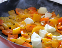 Sweet Peppers & Onion In Skillet Stock Images