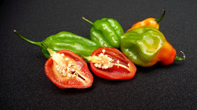 Sweet peppers. Some sweet peppers on black background Royalty Free Stock Image