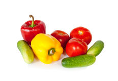 Sweet peppers, tomatoes and green cucumbers isolated on a white Stock Photography