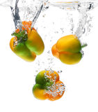 Sweet Peppers in water splash. Composition of 3 sweet peppers including different angles. A particular pepper which had 3 colors Royalty Free Stock Images