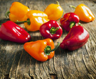 Sweet peppers on wooden background Royalty Free Stock Images