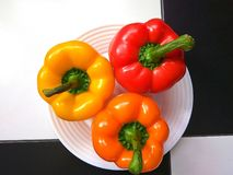 Sweet peppers in three colors Royalty Free Stock Photos