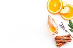 Sweet perfume with fruit fragrance. Bottle of perfume near apple, orange, lavender, cinnamon on white background to. Sweet perfume with fruit fragrance. Bottle royalty free stock photography