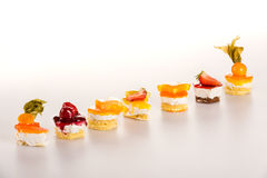 Sweet petite tarts fruit selection creamy desserts Royalty Free Stock Images