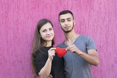 Sweet picture of two lovers with red heart stock photos