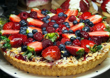 Sweet pie with fresh strawberries, blueberries and raspberries. Spain Stock Photos