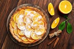 Sweet pie with orange caramelized slices Royalty Free Stock Image