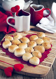 Sweet pie in the shape of heart made from yeast roll buns Stock Image