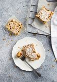 Sweet piece of cake pie with fruit jam and streusel in white plate. On light background. Tasty homemade pie pastry. Vertical photo top view Royalty Free Stock Image