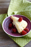 Sweet piece of Scone on the saucer Royalty Free Stock Photo