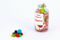 Sweet pieces of happiness. Set of sweets in a bottle as a concept of happiness Stock Images