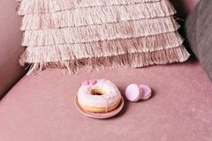 Sweet pink donut on a pink background stock photography