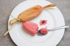 Sweet pink Mexican tamales filed corn dough, food in Mexico royalty free stock image