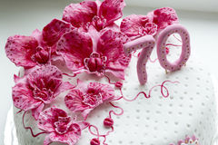 Sweet pink orchids white anniversary cake closeup Royalty Free Stock Photo