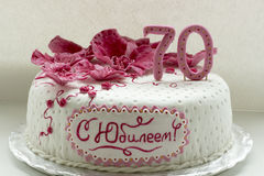 Sweet pink orchids white anniversary cake closeup Royalty Free Stock Photos