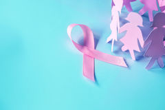The Sweet pink ribbon shape with girl paper doll on blue background for Breast Cancer Awareness symbol to promote in october mo. Sweet pink ribbon shape with stock photography