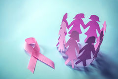 The Sweet pink ribbon shape with girl paper doll on blue background for Breast Cancer Awareness symbol to promote in october mo. Sweet pink ribbon shape with royalty free stock images