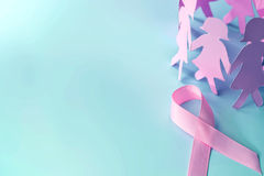 The Sweet pink ribbon shape with girl paper doll on blue backgro Stock Photo