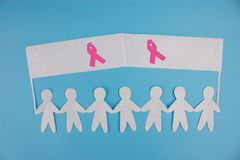 Sweet pink ribbon shape with girl paper doll on blue background for Breast Cancer Awareness symbol to promote in october month cam. Sweet pink ribbon shape with royalty free stock images