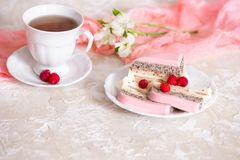 A sweet pink rose cup cake with tea pot and cup on the table in the english garden stock photography