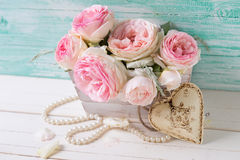 Sweet pink roses in box and decorative heart Royalty Free Stock Photos