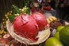 Sweet pitayas fruit. Ripe sweet pitayas fruit from cactus plant in wicker basket Royalty Free Stock Photos