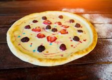 Sweet pizza with cream and fruit for children royalty free stock photos