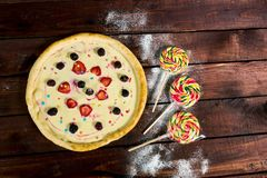 Sweet pizza with cream and fruit for children stock images