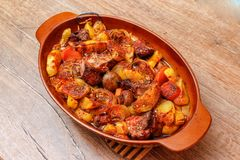 Stew with homemade smoked meat and vegetables in ceramic bowl stock photo