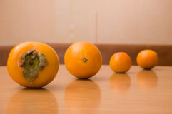 Sweet planets. Picture of fruits lying in line on the wooden table Royalty Free Stock Images