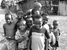 Sweet playful cheeky African children smiling for first photo