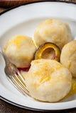 Sweet plum dumplings. Stock Photos