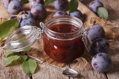 Sweet plum marmalade in a glass jar on the table close-up Royalty Free Stock Photography