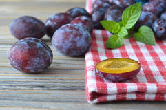 Sweet plums and mint Stock Images