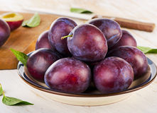 Sweet Plums on   wooden table Stock Photo