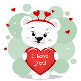 Sweet polar bear in a red bow is worth and keeps in the clutches of a red heart with an inscription, in the style of cartoons. A beautiful polar bear in red bow Royalty Free Stock Photos