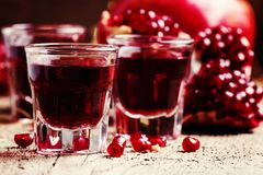 Sweet pomegranate liqueur, still life in rustic style, selective stock images