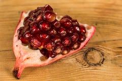 Sweet pomegranate slice close up Stock Image