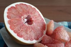 Sweet pomelo peeled on a plate Stock Images