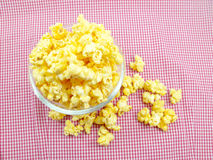 Sweet popcorn in box on red stripe background. Popcorn bucket in box on red stripe background Stock Photo