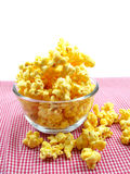 Sweet popcorn in box on red stripe background. Popcorn bucket in box on red stripe background Stock Photography