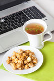 Sweet popcorn food on the table in still life tea party dessert computer, laptop, thyme Stock Image