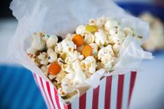 Sweet Popcorn. Full Bag Of Sweet Popcorn With Candies And Sprinkles royalty free stock photo