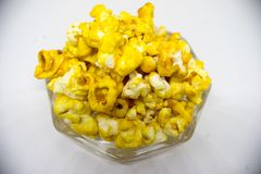 Sweet popcorn  on white background. The Sweet popcorn  on white background. Popcorn, or pop-corn, is a variety of corn kernel, which forcefully expands and puffs Stock Images