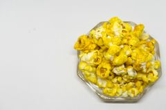 Sweet popcorn  on white background. The Sweet popcorn  on white background. Popcorn, or pop-corn, is a variety of corn kernel, which forcefully expands and puffs Stock Photo
