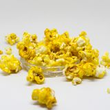 Sweet popcorn  on white background. The Sweet popcorn  on white background. Popcorn, or pop-corn, is a variety of corn kernel, which forcefully expands and puffs Royalty Free Stock Image