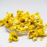 Sweet popcorn  on white background. The Sweet popcorn  on white background. Popcorn, or pop-corn, is a variety of corn kernel, which forcefully expands and puffs Royalty Free Stock Photo